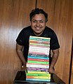 Devdutt Pattanaik with his own 20 books.jpg