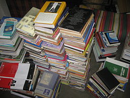 Disorganized books piling one another