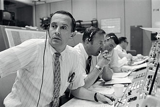 Apollo 11 - CAPCOM Charles Duke, with backup crewmen Jim Lovell and Fred Haise listening in during Apollo 11's descent