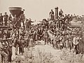 East and West Shaking hands at the laying of last rail Union Pacific Railroad - Restoration.jpg