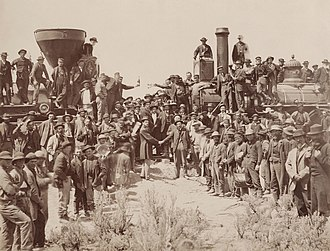"Transcontinental railroad - The ceremony for the driving of the ""Last Spike"" the joining of the tracks of the CPRR and UPRR grades at Promontory Summit, Utah, on May 10, 1869, Andrew J. Russell's ""East and West Shaking Hands at Laying of Last Rail."" May 10, 1869."