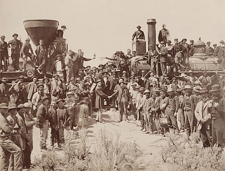 May 10 - The First Transcontinental Railroad in North America is completed East and West Shaking hands at the laying of last rail Union Pacific Railroad - Restoration.jpg