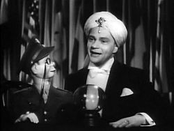Ventriloquist Edgar Bergen and his best-known sidekick, Charlie McCarthy in the film Stage Door Canteen (1943).