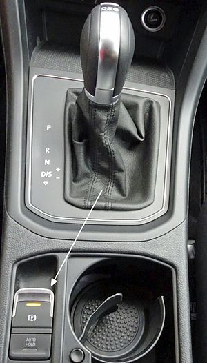 Parking brake - Electric park brake switch on the center console of a Volkswagen Touran