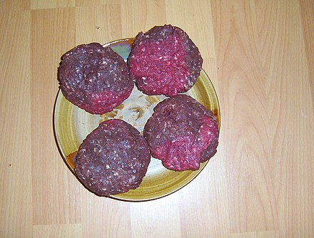 Approximately 0.45 kg (1 lb) of ground elk meat formed into patties; they have relatively low fat content Elkpatties.JPG