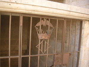 Torres de Serranos - Valencian coat of arms with the crown of the kingdom and the bat, decorating a grille of a door to the interior staircases.