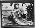 Eskimo girl playing accordian on ship(?), in the Arctic LCCN99400856.jpg