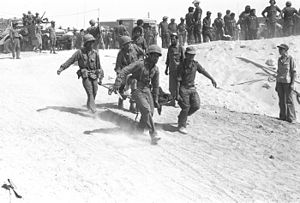 Israeli casualties of war - An IDF medical crew evacuating an injured soldier from the battle field during the Yom Kippur War. The Israel Defense Forces suffered 2,297 casualties and more than 7,200 soldiers were injured.