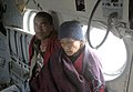 Evacuated mother and son being flown to a safer place by an Indian Air Force (IAF) helicopter following a recent massive earthquake in Nepal.jpg