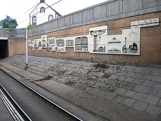 Exhibition Centre railway station - A mural of Clydeside landmarks by Platform 1