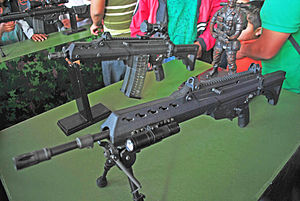FX-05 Xiuhcoatl - Second-generation FX-05 assault rifle and carbine on display at a Mexican Army public relations event in Constitution Square. Note the black colored finish and the mounted red dot scope on the carbine.