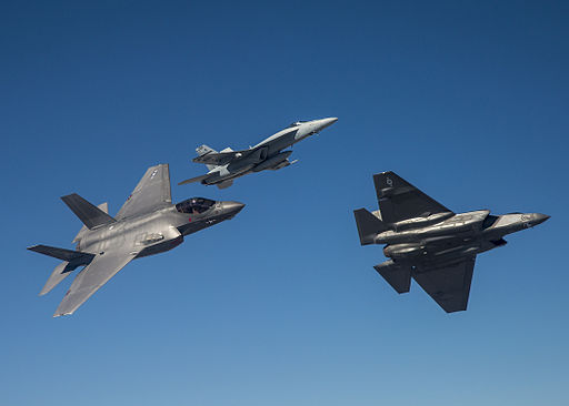F-35Cs of VFA-101 in flight with FA-18E of VFA-122 in April 2015