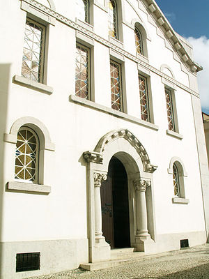 Lisbon Synagogue - The white facade of the main building located within the courtyard