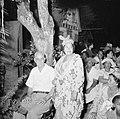 Feestelijk geklede vrouw naast een man op een feest in Paramaribo, Bestanddeelnr 252-2459.jpg