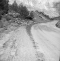 File-Flood damage on park road near utility area; cloudburst at 6-30 p.m. leading to 1.08-inches of rain. -One of two images on film (87f9857f5bce470f8bc734e07676e754).tif