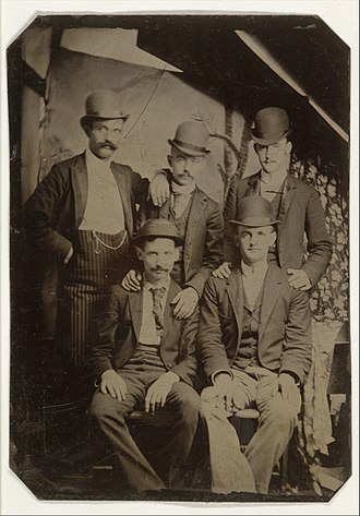 "Butch Cassidy's Wild Bunch - 1892 tintype portrait of five members of the ""Wild Bunch"" gang dressed in bowler hats and city clothes shows, clockwise, from the top left, Kid Curry, Bill McCarty, Bill (Tod) Carver, Ben Kilpatrick, and Tom O'Day"