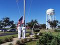 Flag lowering during Disestablishment Ceremony of Naval Station Pascagoula 060928-N-6344D-061.jpg