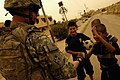 Flickr - DVIDSHUB - Iraqi Police Officers Hand Out School Supplies in Mosul, Iraq.jpg