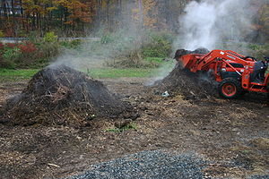 English: Turning a hot compost pile