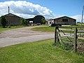 Footpath through the farm buildings - geograph.org.uk - 850801.jpg