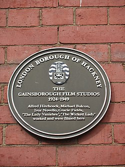Photo of Gainsborough Film Studios, Alfred Hitchcock, Michael Balcon, Ivor Novello, and 1 other