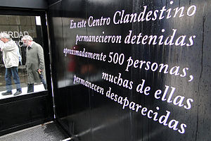 International Association of Genocide Scholars - Image: Genocide Scholars IAGS Visitors Walk Past Memorial Sign Olimpo Detention and Torture Center Buenos Aires Argentina