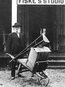 George Fiske outside studio with photgraphy equipment.jpg