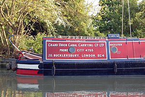 Grand Union Canal Carrying Company - A reproduction of the livery carried by GUCCC boats from 1937 until the outbreak of World War II. This is Bicester, built by Harland and Wolff. Until the 1980s it was regularly used to carry cargo including wheat, lime juice and retail coal. The boat is now converted as a cruiser with a full-length cabin.