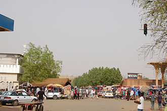 Niamey Grand Market - The edge of the Grand marché. The distinctive tree-like pillars which surround the central buildings can be seen on the extreme right of this picture.