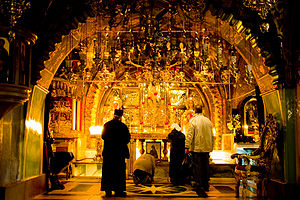Prostration - Eastern Orthodox pilgrims making prostrations at Golgotha in the Church of the Holy Sepulchre, Jerusalem.