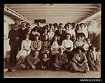 Group photo of passengers on a ship's deck (7641688948).jpg