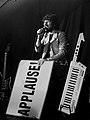 Gruff Rhys from Neon Neon sporting his Applause! Sign.jpg