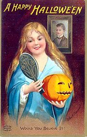 In this Halloween greeting card from 1904, divination is depicted: the young woman looking into a mirror in a darkened room hopes to catch a glimpse of the face of her future husband.