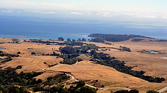 Hearst Ranch - Hearst Ranch,  looking down the access road from Hearst Castle to Highway 1 and  San Simeon.  Wooded peninsula is San Simeon Point.