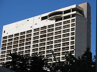 Battle of the Hotels - The Holiday Inn Beirut was used as a vantage point for militias and was badly damaged