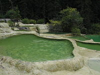 Lime sinter terrace landscape Huanglong