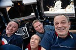 ISS-56 Crew members gather inside the Cupola.jpg