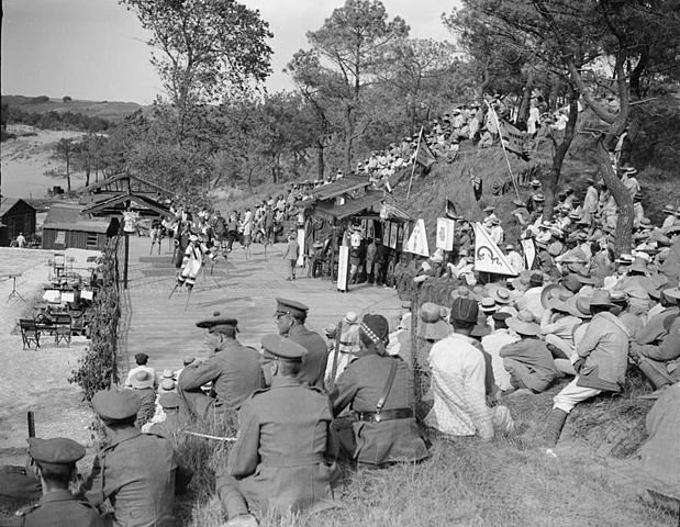 Members of the Chinese Labour Corps entertain British troops and Chinese workers at an open-air theatre at Etaples in 1918