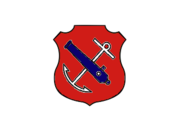 An insignia in the form of a red shield. On the shield are a white anchor crossed by a blue cannon barrel.