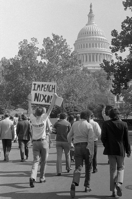 A demonstrator demanding Nixon's impeachment, October 1973 Impeach Nixon retouched.jpg