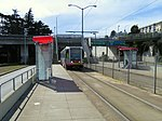 Inbound train at San Jose and Glen Park station, March 2018.JPG