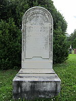 Old headstone with rounded top