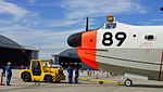 JMSDF US-1A(9089) with 5t class tractor(MC-0514) at Iwakuni Air Base September 14, 2014.jpg