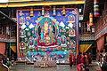 Jakar tshechu, Guru Rinpoche thongdrel with the Guru, his two wives and eight manifestations (15843686901).jpg