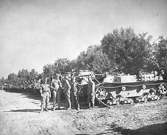 Sōkō Sagyō Ki - A Sōkō Sagyō Ki (frontmost) amongst a Japanese tank unit after surrender in Tianjin, with its external parts dismantled