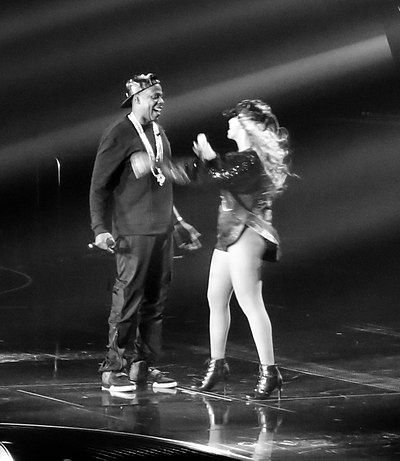 "Jay-Z embraces wife Beyonce after his performance of ""Tom Ford"" on The Mrs. Carter Show World Tour, 2013 Jay-Z Beyonce.jpg"