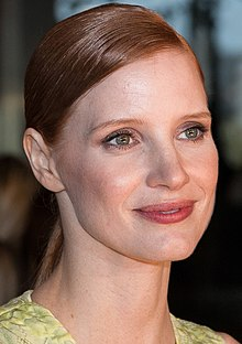 A head shot of Chastain as she smiles away from the camera