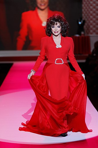 Collins at The Heart Truth's Red Dress Collection Fashion Show in 2010 Joan Collins in Stephane Rolland.jpg