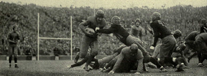 Joe Gembis - Gembis carrying ball against Iowa, 1928