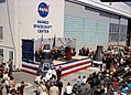 John F. Kennedy speaks in front of CCAFS Hangar S (KSC-62PC-0015).jpg